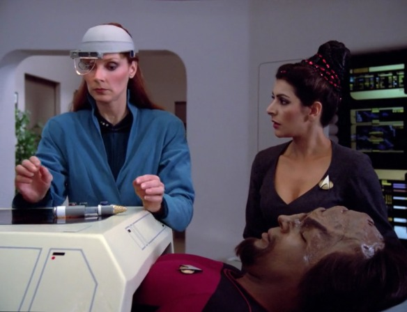 TROI: And here I was thinking my wigs were the low point of our wardrobe.